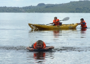 Kayaking and swimming down at Corry strand, Leitrim, Ireland